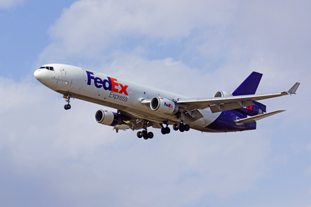 Airplane FedEx cargo MD-11 jet landing at airport Editorial
