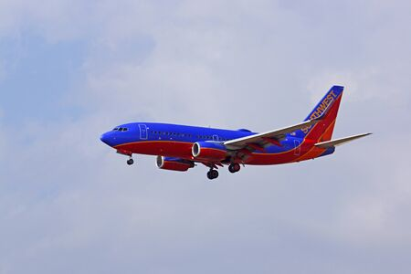 southwest: Airplane Southwest Airlines 737 jet landing at airport