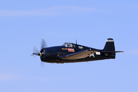 motor launch: Airplane Navy WWII F6F Hellcat flying at air show