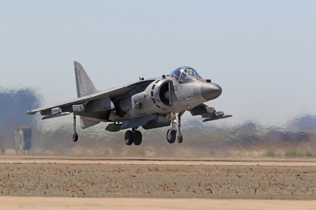 Jet AV-8 Harrier airplane landing at air show Editorial