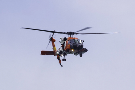 troop: Coast Guard helicopter with safety diver Editorial