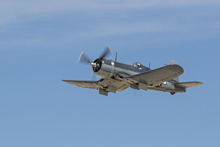 Airplane WWII vintage Corsair fighter aircraft flying Editorial