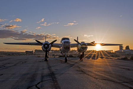 Airplane vintage WWII B-25 Mitchell bomber at sunrise