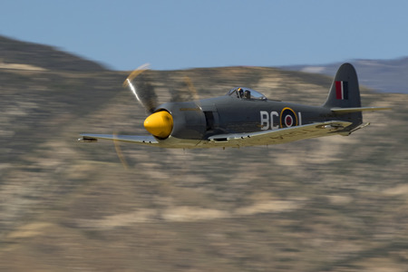 Airplane Hawker Sea Fury flying at air show in California