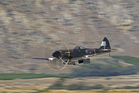kampfhund: Airplane vintage WWII Spitfire aircraft flying at air show Editorial