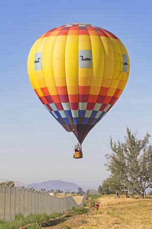 Balloon landing at Balloon Festival Stock Photo