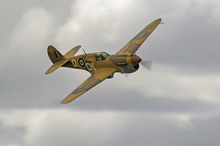 Airplane WWII P-40 Warhawk flying at air show