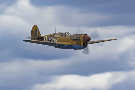 Airplane P-40 Warhawk fighter aircraft flying at air show
