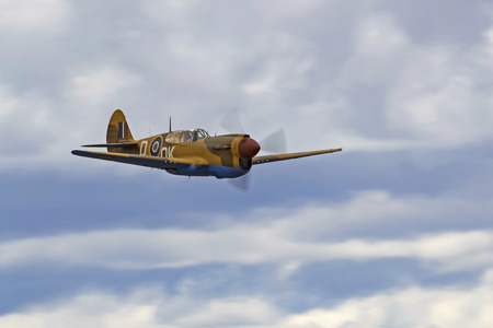 motor launch: Airplane P-40 Warhawk WWII fighter flying at air show