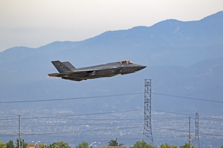 Airplane F-35 Lightning jet fighter flying at air show