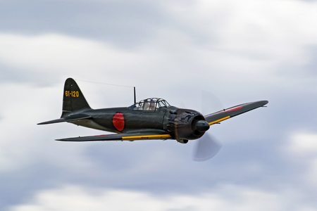 Airplane WWII Japanese Zero fighter flying at air show