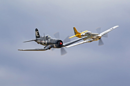 Airplanes F4-U Corsair and P-51 Mustang WWII fighters flying together