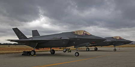 gloom: Airplanes a pair of F-35 Lightning at air show runway Editorial