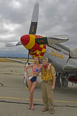 Airplane P-51 Mustang  with pilot and pin-up model Stock Photo - 81094035