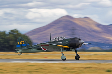 Airplane WWII Zero fighter take-off at air show