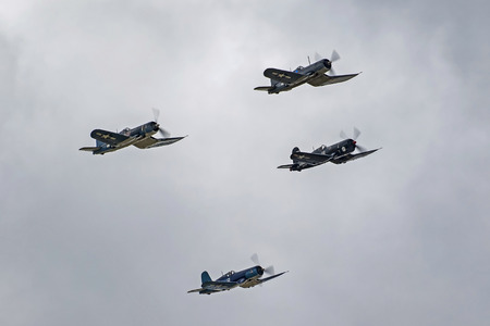 Airplanes group of F4-U Corsair WWII aircraft flying in formation Editorial