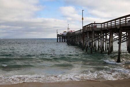 Beach pier at California shore Stock Photo