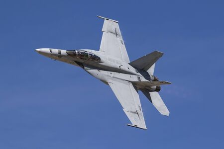 above 18: Airplane F-18 Hornet jet fighter flying fast above the air show