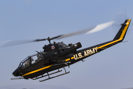 Helicopter UH-1 Cobra attack aircraft flying at the airshow Editorial