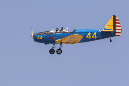 Airplane Fairchild PT-19 WWII trainer aircraft flying Editorial