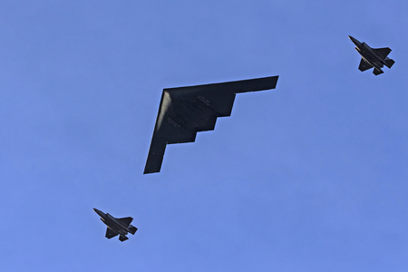 Airplanes including the B-2 bomber fly over the Rose Parade