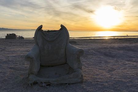 Desert abandoned chair at the Salton Sea shore