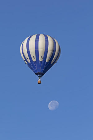 Balloon flying over the moon Stock Photo