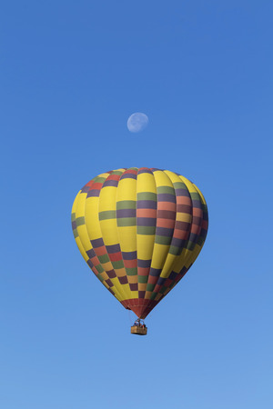 Balloon ride during morning moon Stock Photo
