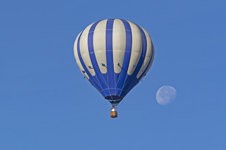 Hot air balloon and full moon Stock Photo