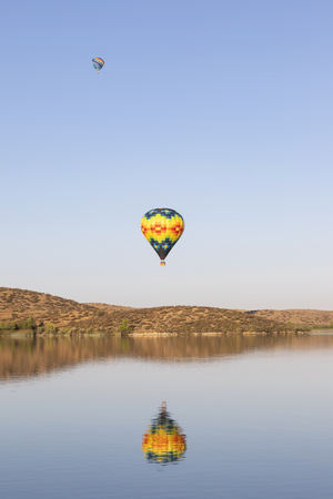 Hot air balloon rides over California lake