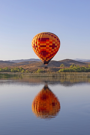 Hot air balloon launch over California lake