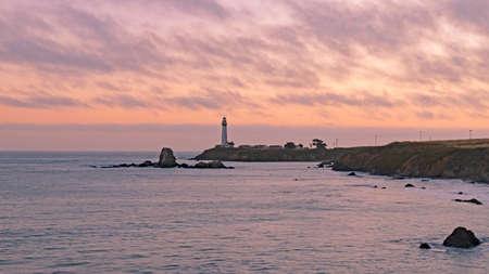 Lighthouse at dusk along California coast