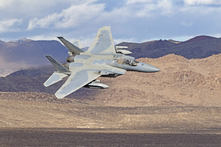 Jet fighter F-15 Eagle flying low at Star Wars Canyon in the Death Valley