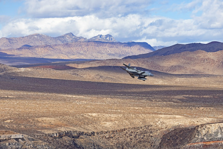 Jet fighter flying at Jedi Transition in California's Death Valley Stock Photo - 122470491