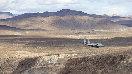 Jet fighter flying at Star Wars Canyon in Death Valley Stock fotó