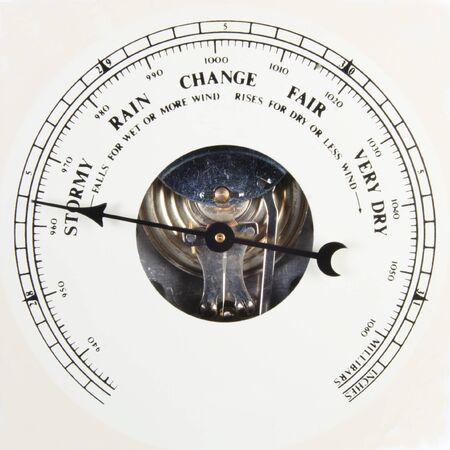atmospheric pressure: A close up of an aneroid barometer with the dial set to stormy