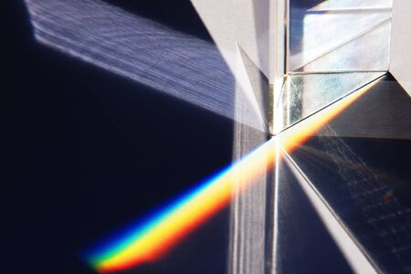 A close up of a prism refracting white light into the colours of the spectrum Stock Photo - 1397790