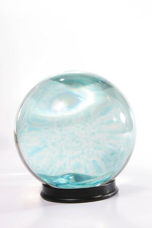 Crystal ball with swirling blue shapes