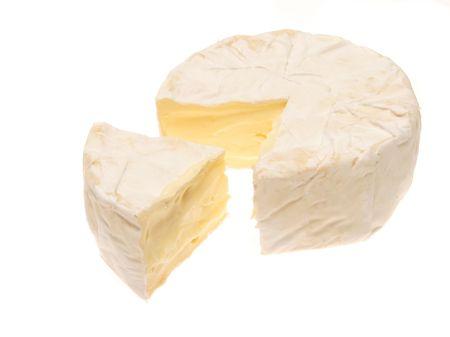 camembert: Camembert cheese isolated on white Stock Photo