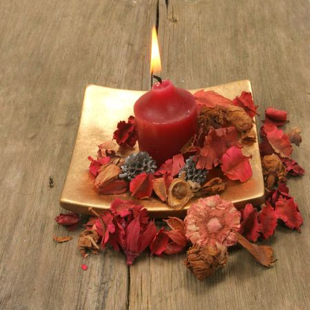 Candle and pot pourri on old wood Stock Photo - 3056582