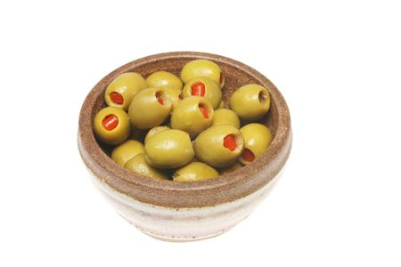 Bowl of stuffed green olives isolated on white photo