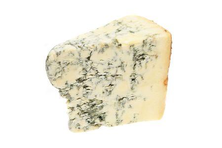 stilton: Wedge of stilton cheese isolated on white