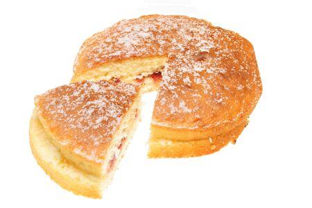 Sliced sponge cake isolated on a white background photo