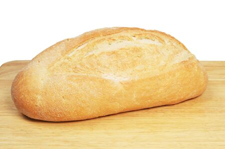 bloomer: White bloomer loaf on bread board