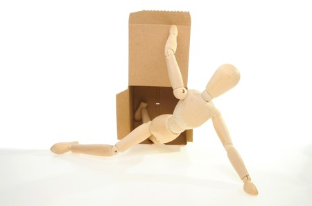 artists dummy: An artists dummy opens and crawls out of a box