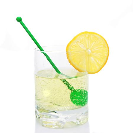 Fizzy drink in tubler with stirrer and lemon photo