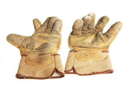 rigger: Pair of well worn riggers gloves isolated on white Stock Photo