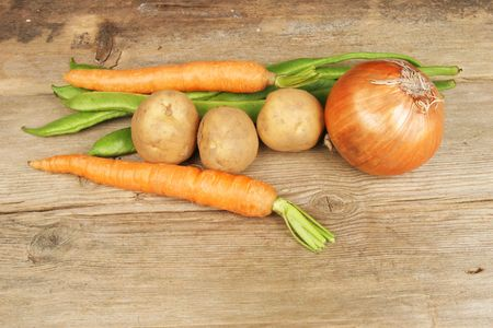 carot: Selection of fresh vegetables on rustic wood