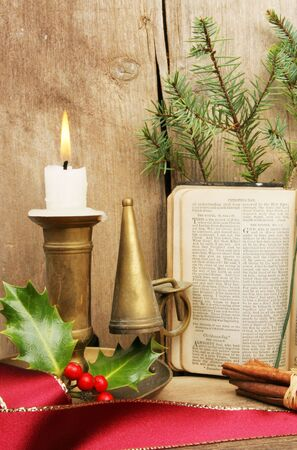 Christmas still life with burning candle and a prayer book photo