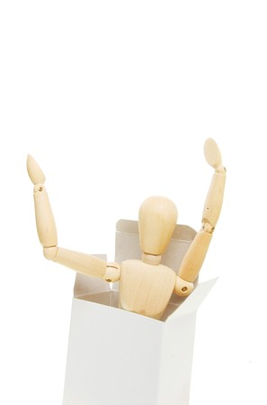 Artist's mannequin emerges from a cardboard box Stock Photo - 6992647
